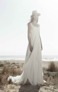 A textured overlay adds depth to this simple and carefree wedding dress from Ir De Bundo