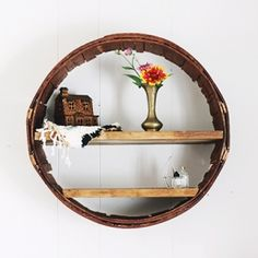 Spruce up your room with a new circular shelf made out of an old basket!