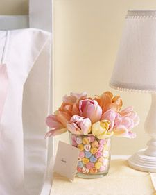 A vase within a vase! Fill the gap between vases with conversation hearts, and place a bouquet of tulips in the smaller vase.