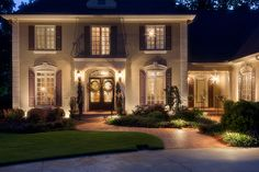 I love the double doors and how green the lawn looks!  The lights are amazing too.