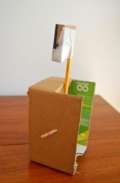 Homemade catapult from cardboard, tape, rubber band, pencil, and toothpicks. Awesome!