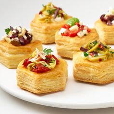 Golden, flaky puff pastry cups hold an assortment of savory fillings like artichokes and sun-dried tomato, mozzarella and roasted red pepper, oil-cured olives and cream cheese and/or marinated mushrooms, olives and feta cheese. They're incredibly good and sure to be a hit at your next party. Comments
