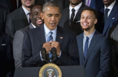 Golden State Warriors players, Draymond Green, left, and Stephen Curry, right, reacts to watching President Barack Obama, center, mimicking Curry's 'clowning' on the basketball court, during a ceremony honoring the 2015 NBA Champions during a ceremony in the East Room of the White House in Washington, Thursday, Feb. 4, 2016.
