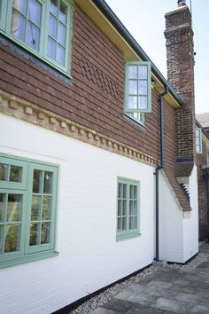PERFORMANCE triple glazed timber windows with interstitial glazing bars at Sussex low energy retrofit https://www.greenbuildingstore.co.uk/sussex-low-energy-retrofit/