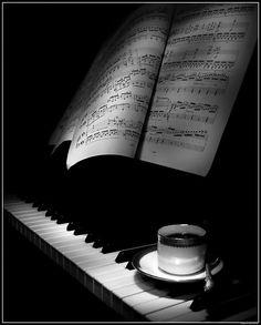 Study piano score over morning coffee