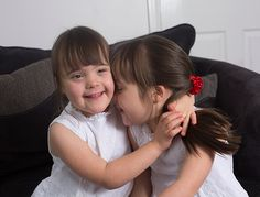5-year-old Down's syndrome identical twins Abigail and Isobel are almost impossible to tell apart - and they're also one in a million.