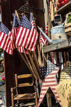 Patriotic Pride...old chair, bee skep, zinc watering can with burlap, &...flags.