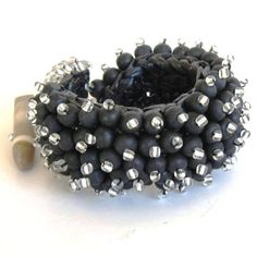 DBANE WOOD       wood and glass beads on crocheted raffia base  ZAR 375