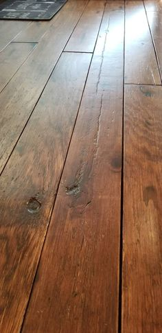 DIY Rustic Farmhouse Wide Plank Plywood Flooring - a closeup of the distressing on the barn board plywood flooring in the kitchen - Web 2020 Best Site Rustic Hardwood Floors, Diy Wood Floors, Farmhouse Flooring, Painted Floors, Diy Hardwood Floor, Distressed Wood Floors, Reclaimed Wood Floors, Plywood Plank Flooring, Diy Flooring