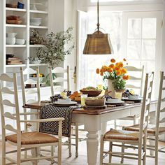 Country dining table - love the ladderback chairs.
