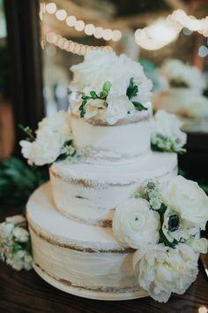 Semi naked wedding cake with white flowers   Earthy Sage  Dusty Blue Wedding at Rustic Acres Farm. For more farm wedding ideas, visit burghbrides.com! #weddingcake #seminakedweddingcake