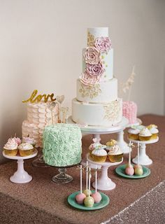 whimsical pastel cake and dessert table