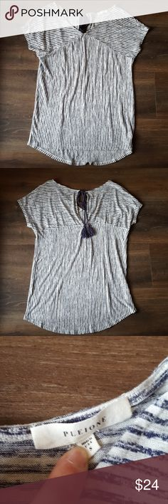 Pleione Navy and white stripe tee Slightly v-necked with a keyhole back and tassel tie detail. Super cute, soft and comfy shirt.   82% rayon 18% Polyester Pleione Tops Tees - Short Sleeve