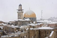 A heavy winter storm descended on parts of the Middle East on Friday, with snow forcing the closure of all roads leading in and out of Jerusalem and sprinkling Israel's desert with a rare layer of white. Snow also fell in parts of the West Bank, Lebanon, Jordan and Syria as a cold front swept through the region. The snowstorm added to the burdens for Syrians displaced by war and living in tents in Jordan's Zaatari refugee camp. Some tents collapsed or suffered damage, and streets were turned…