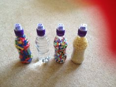 Weighing lesson. Fill the same empty bottles with different things. I used straws, rice and pasta, water and Hama beads. Using pan balance can the children place them in order of weight?