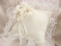 Ring Bearer Pillow  Wedding Ring Pillow  Ivory by nanarosedesigns, $29.00  Such a pretty pillow.  Love the ribbony, curly lace with the flowers.