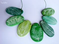 These are polymer clay - but I like the idea of real rocks, drilled this angle with the instructions I already pinned, and carved with the leaf patterns, like the other instructions I've pinned.  That would be an awesome look!