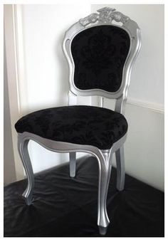 A Shimmery Silver French/Italian Dining Chair With Black Damask Style Fabric Added With A Black Lace Trim