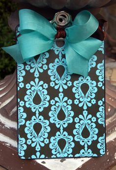 DIY idea ~ use wrapping paper and mod podge it to a clipboard. Seal it with appropriate sealer. Make a beautiful bow and hot glue it on.   Fabric can also be used with heat sealer or appropriate glue.