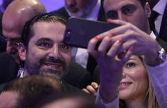 A woman takes a selfie with PM Saad Hariri at the end of a regional banking conference, in Beirut, Lebanon. (Hussein Malla / AP) http://pow.photos/2017/lebanon-pow-23-29-november/