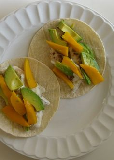 Creamy Chicken Tacos with Avacado and Mango. Fast easy and you'll feel like a chef.