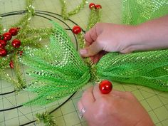 Christmas Wreath Tutorial using Wide Foil Deco Poly Mesh, Pencil Ball Wreath and RAZ Frosted Cookie Ornaments ...see the Blog post http://www.trendytree.com/blog/deco-poly-mesh-wreath-tutorial-using-raz-cookie-decorations/