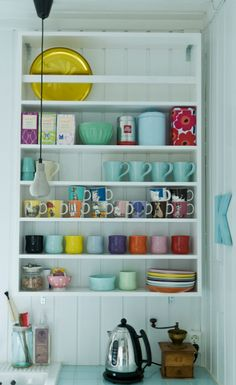 Colorful kitchenware on open shelving. And electric kettle, the one glorious thing that American kitchens lack!