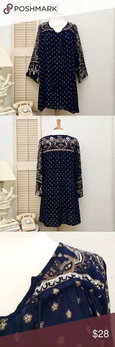 ANGIE Rayon Crêpe Boho Bell Sleeve Tunic Dress Dress/tunic. Color: navy tan brown black cream. Labeled size medium, but could fit a large. Regal paisley print. 100% rayon crêpe. Drawstring cords with tassels at upper chest. Flowy loose fit. Wide/bell sleeve, Slv length 21.5 inch. Chest: 20 inches across. Hips: 24 inches across. Length: 34.5 inches. Boho, hippy, ethnic, festival. Used and in good condition.❤ Angie Dresses