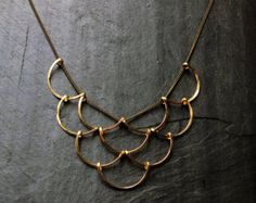Cocoon - By Loop Jewelry Featured: Formed and forged gold fill pendants on brass chain, with gold fill lobster clasp. Pendants are also available in formed and forged sterling silver, brass, or silver and gold. Chain is brass as shown. Pendant measures- approximately L 2.6 x .9 W Featured chain length 30 Other chain lengths available at: 16.5 18 24 28 32 Always, all items come gift wrapped for whatever your occasion may be. Thank you so much for checking it out! xo Loop Jewelry Copyrigh...