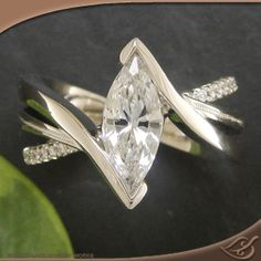 #GreenLakeMade platinum wrap mounting for a stunning marquise diamond. #Ido #EngagementRing