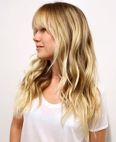 Layered Wavy Blonde Hairstyle With Bangs
