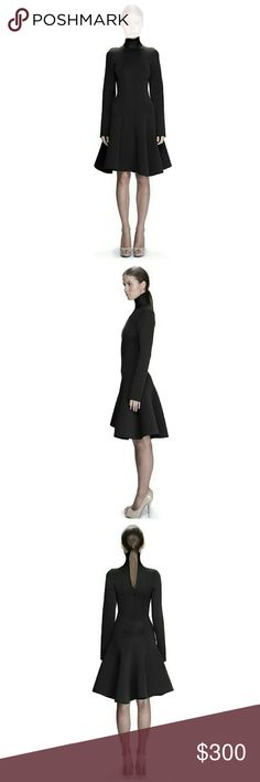 """Black Sleeved Neoprene Flared Dress BLACK NEOPRENE DRESS  MODEL'S HEIGHT 5' 11"""" 