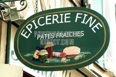 Wooden painted delicatessen shop sign , France stock photo
