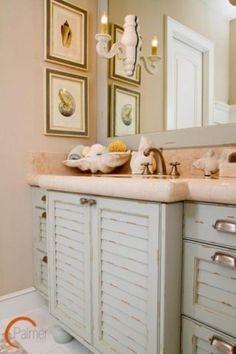 Whitewash bathroom cabinets with sea shell decor