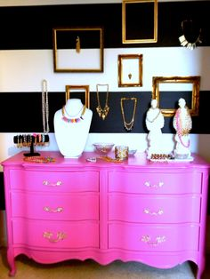 Black and white walls with bright pink french dresser