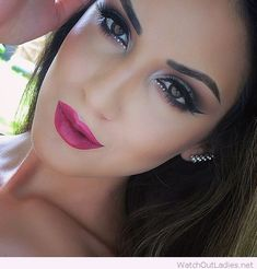 Black and grey eye makeup with pink lips
