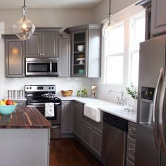 Gauntlet Gray SW 7019 kitchen cabinets Ranch Kitchen, Condo Kitchen, Kitchen Redo, Home Decor Kitchen, Kitchen Ideas, Grey Painted Kitchen, Grey Kitchen Cabinets, Painting Kitchen Cabinets, Gauntlet Gray