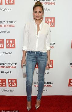It's a jeans day: The Sports Illustrated Swimsuit beauty opted for faded denim and off-white blouse with heels while attending the UNIQLO store opening in Los Angeles on October 9