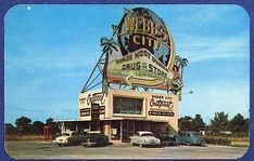 This is an old vintage postcard of Webb's City Outpost on Grandy Bridge Highway at St. Petersburg, Florida with a huge neon sign on top advertising Webb's City World's Most Unusual Drug Store . Besides the words on the sign t is the world, an airplane, palm trees and a mermaid on it. T are several old cars or automobiles in front. T is also a red phone booth next to the building. It is postally unused and wear is minimal. T is a tiny hole top left w it looks to have been thumb tacked somew It is Florida Style, Florida Girl, Old Florida, Vintage Florida, Florida Home, Webb City, Places In Florida, St Petersburg Florida, Drug Store