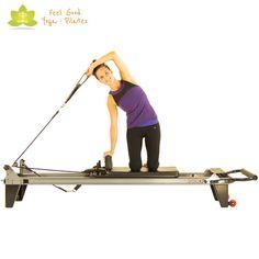 side bend press pilates reformer exercise start position
