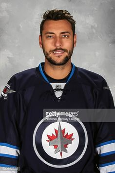 Ondrej Pavelec of the Winnipeg Jets poses for his official headshot for the 2015-2016 season on September 17, 2015 at the MTS Centre in Winnipeg, Manitoba, Canada.