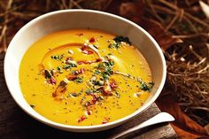 With pepitas for crunch and dried cranberries for sweetness, this creamy pumpkin soup is extra special.
