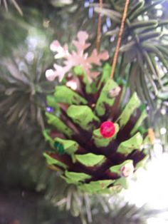 Paint an upside down pine cone, add glitter and star sequin and you now have an ornament!