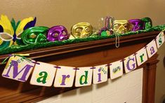 Mardi Gras decoration Mardi Gras Banner Mardi Gras party  Photo prop Mardi Gras sign garland. $20.00, via Etsy.