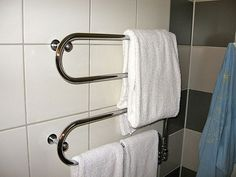 There's nothing more soothing than being wrapped in a warm soft towel. Install an affordable plug-in warmer rack to heat your towels. It'll make getting out of a hot morning shower that much more pleasant. For the how-to, visit DIY Central. Towel Radiator, Towel Warmer, Shower Towel, Master Bath Remodel, Soft Towels, Home Interior Design, Easy Diy, Towel Racks, Small Homes