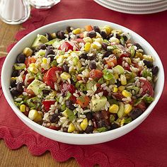 This colorful, south-of-the-border rice salad comes together quickly and features rice tossed with salsa, fresh veggies, lime juice, olive oil, and cilantro.