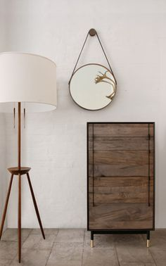 Continuing the round mirror obsession. Love the drawers and lamp too...