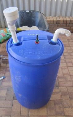 The input pipe, gas-out valve and output pipe all fitted to the top of the barrel