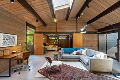 Photo 14 of 15 in A Spectacular Roger Lee Midcentury Hits the Market in Berkeley for $1.3M - Dwell Hanging Fireplace, Sliding Wood Doors, Living Spaces, Living Room, Building A Deck, Prefab Homes, Two Bedroom, Concrete Floors, Ground Floor