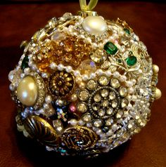 vintage jeweled ball tree ornament. I glued old broken jewelry to a gold styrofoam ball, added pearls here and there, then sprayed with gloss finish. Debbie Hall, 2014
